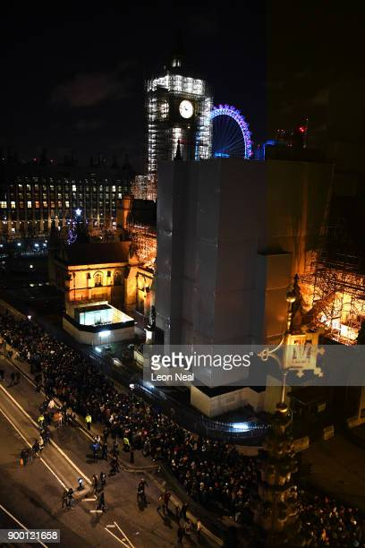 Scaffolding covers Big Ben while crowds queue to get into the waterside position to watch the fireworks show to ring in the near year on December 31...
