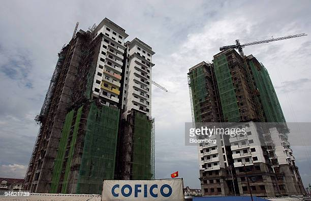 Scaffolding encases residential tower blocks under construction in Hanoi Vietnam on Sunday August 20 2006