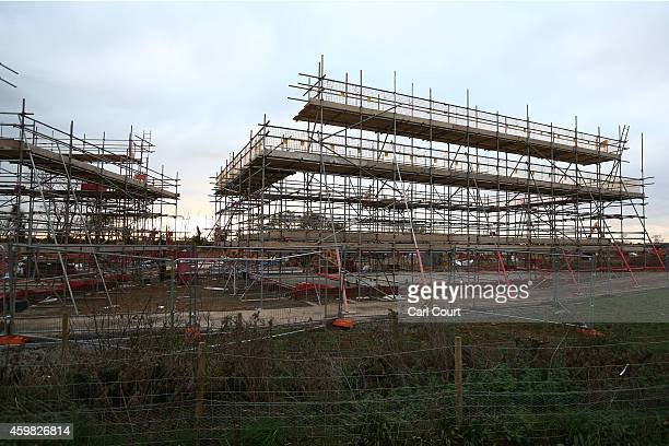 Scaffolding is erected at the site of the first ecotown in the United Kingdom on December 2 2014 in Bicester England Up to 13000 new homes are due to...