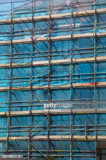 scaffolding on building - richard drury stock pictures, royalty-free photos & images