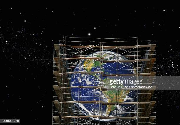 Scaffolding over the planet earth