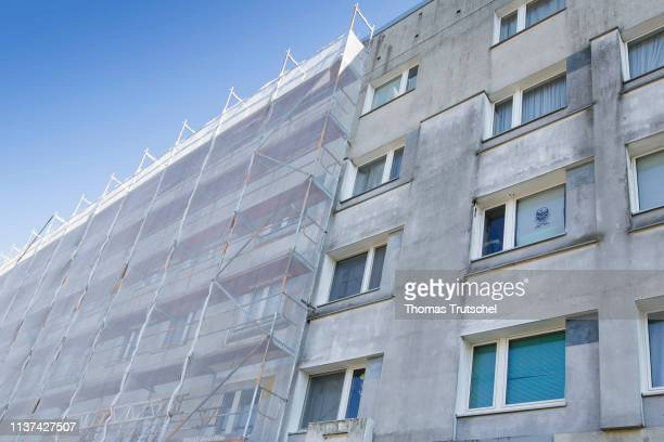 A scaffolding stands on a block of flats for a renovation on April 15 2019 in Berlin Germany