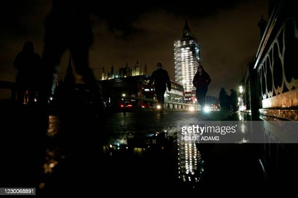 """Scaffolding surrounding the Elizabeth Tower, commonly known by the name of the bell, """"Big Ben"""", and the Palace of Westminster, home to the Houses of..."""