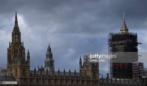 Scaffolding surrounds the newly revealed restored spire of the Elizabeth Tower, commonly known by the name of the bell Big Ben, at the Palace of...