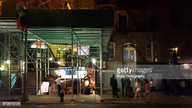 Scaffoldings at St. Mark's Place (East Village, New York City) at night