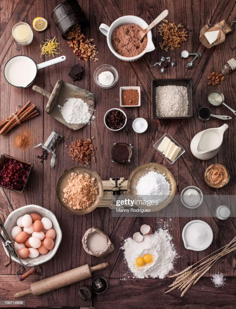 Scale and baking ingredients on wooden table : Stock Photo