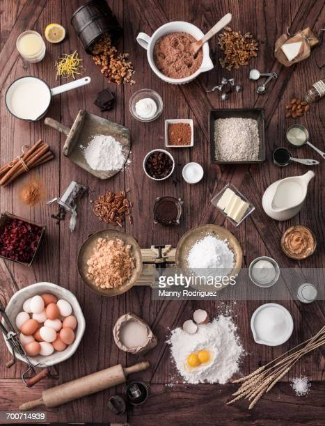 Scale and baking ingredients on wooden table