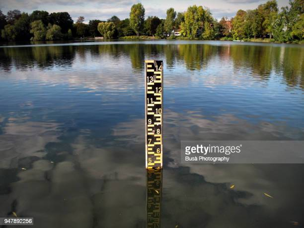 scale indicating water level in a lake in berlin, germany - floods and drought stock pictures, royalty-free photos & images