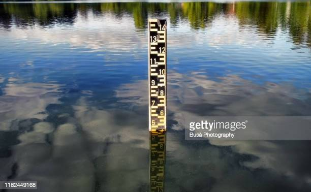 scale indicating water level in a lake - floods and drought stock pictures, royalty-free photos & images