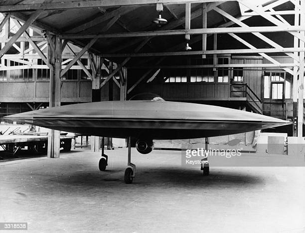 A 3/5 scale model of a proposed VTOL 'flying saucer' aircraft the Couzinet Aerodyne RC360 on display at a workshop on the Ile de la Jatte in...