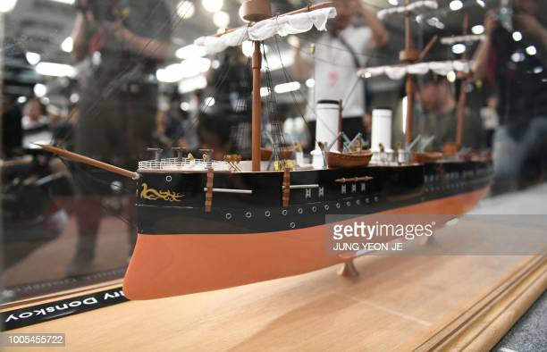 A scale model of Imperial Russian naval cruiser the Dmitri Donskoi is seen during a press conference on a Russian 'treasure' ship in Seoul on July 26...
