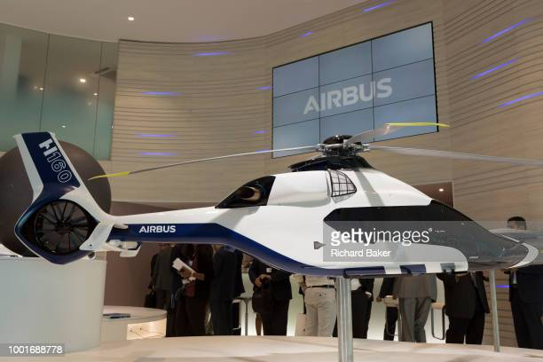 A scale model of the Airbus H160 helicopter and Airbus employees in the company's hospitality chalet at the Farnborough Airshow on 18th July 2018 in...