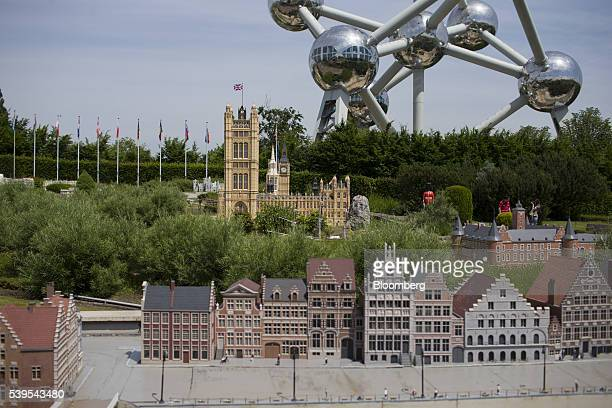 A scale model of the British Houses of Parliament stands on display as the Atomium is seen behind at the Mini Europe theme park in Brussels Belgium...