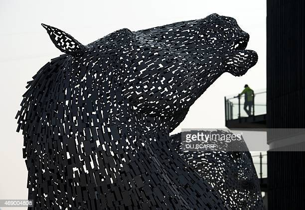 A scale model of 'The Kelpies' giant horsehead sculptures in Falkirk Scotland is displayed on the opening day of the Grand National Festival horse...