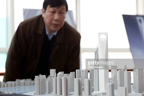 A scale model shows a revised design for a World Financial Centre designed by Forest Overseas Co a wholly owned subsidiary of Japans Mori Building Co...