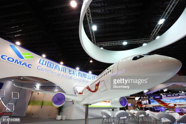 A scale model the Commercial Aircraft Corp of China Ltd CR929 aircraft sits on display at the Singapore Airshow held at the Changi Exhibition Centre...