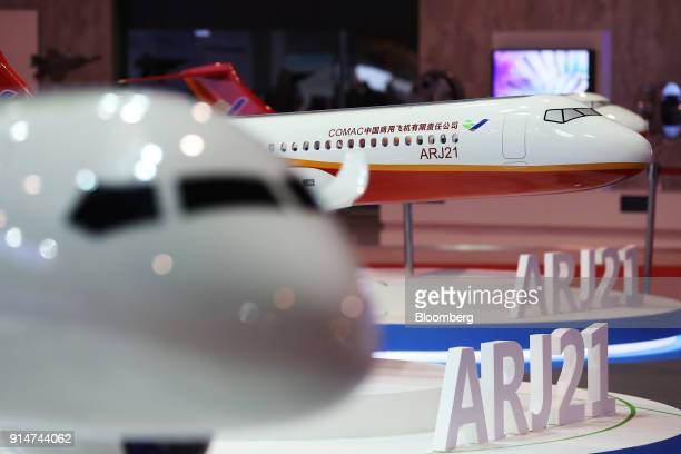 Scale models of the Commercial Aircraft Corp of China Ltd CR929 aircraft sit on display at the Singapore Airshow held at the Changi Exhibition Centre...