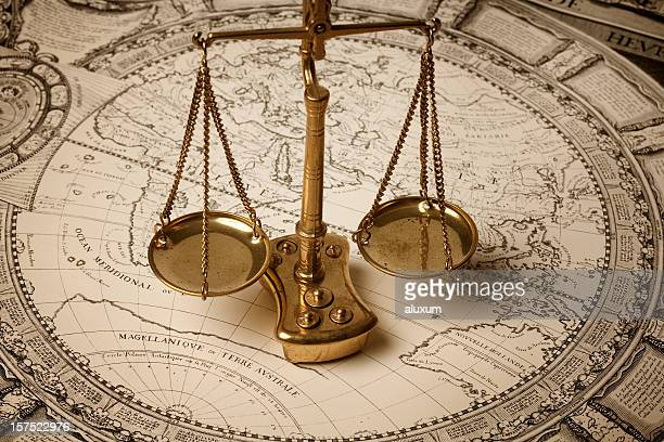 Scale of justice on ancient map