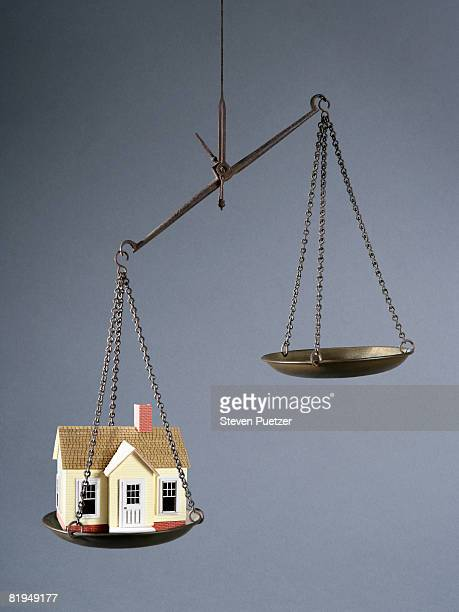Scale weighing the value of a home