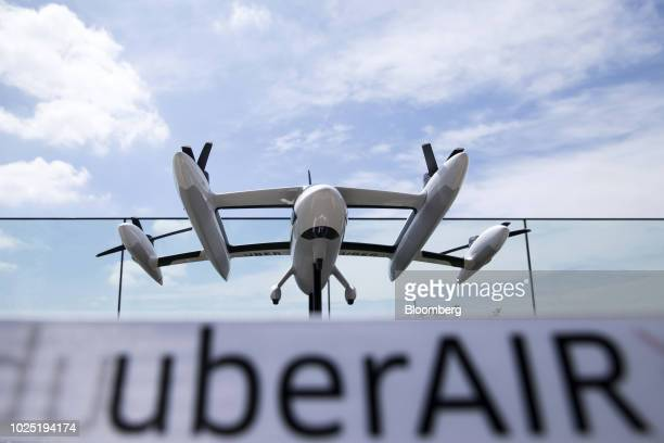 A scaled model of Uber Technologies Inc's eCRM003 an electric vertical takeoff and landing jet is displayed during the Uber Elevated Asia Pacific...