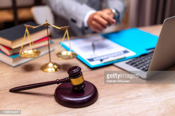 scales of justice and judge gavel on table. - supreme court justice stock pictures, royalty-free photos & images