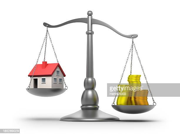 Scales with house and money - isolated / clipping path