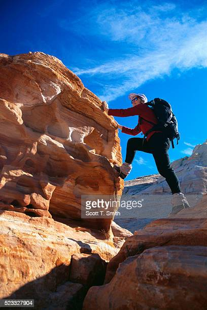 scaling sandstone mounds - valley of fire state park stock pictures, royalty-free photos & images