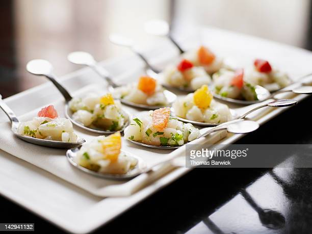 scallop tartare, winter citrus on spoon - appetizer stock pictures, royalty-free photos & images