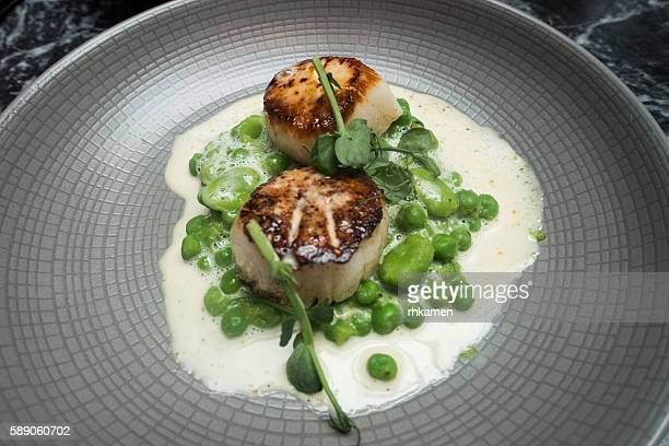 Scallops, peas, feves, fish veloute