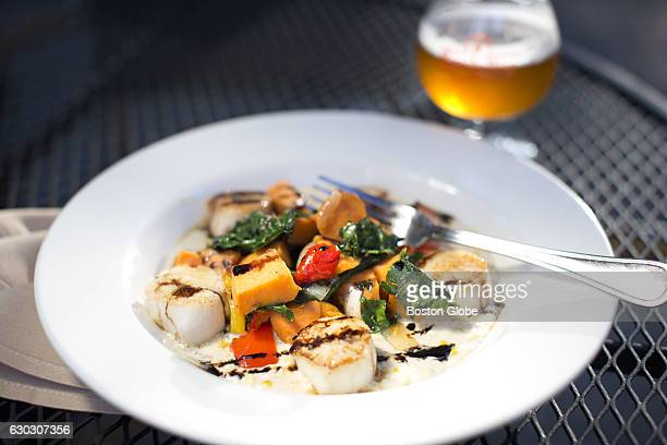 Scallops with sweet corn coulis are pictured at Rapscallion Table & Tap in Acton, MA on Sep. 24, 2015.
