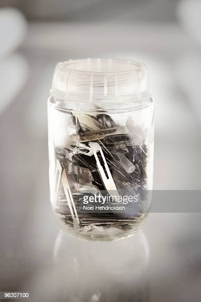 scalpel blades in jar - scalpel stock photos and pictures