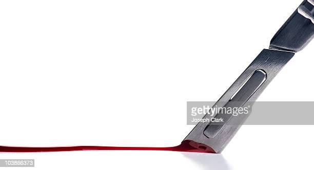 Scalpel cuts and draws blood