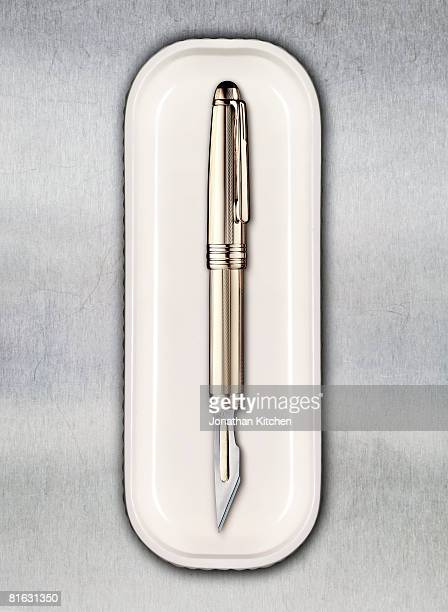 scalpel pen in a tray - scalpel stock photos and pictures