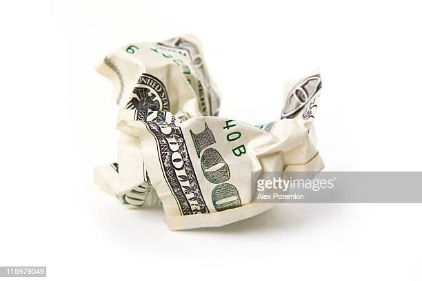 scam. crumpled one hundred dollars banknote
