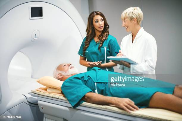 mri scan preparation. - scientific imaging technique stock pictures, royalty-free photos & images