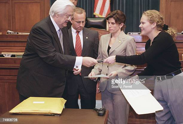 SCANDALHouse Judiciary Committee Chairman Henry Hyde RIll returns a pen to the House employee after signing for his copy of independent counsel...