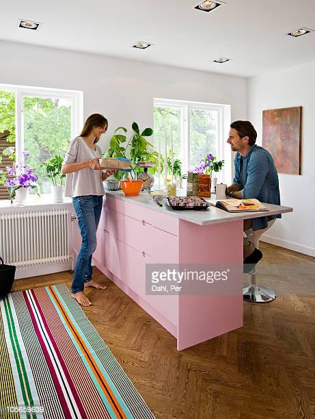 Scandinavia, Sweden, couple preparing food in kitchen