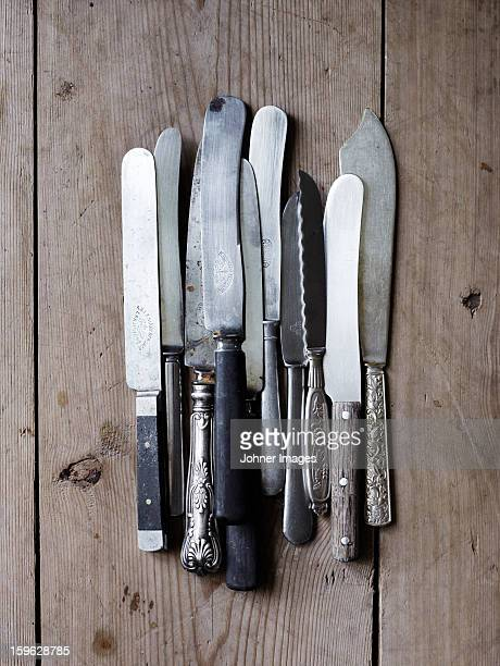 Scandinavia, Sweden, Knives on wooden background, close-up