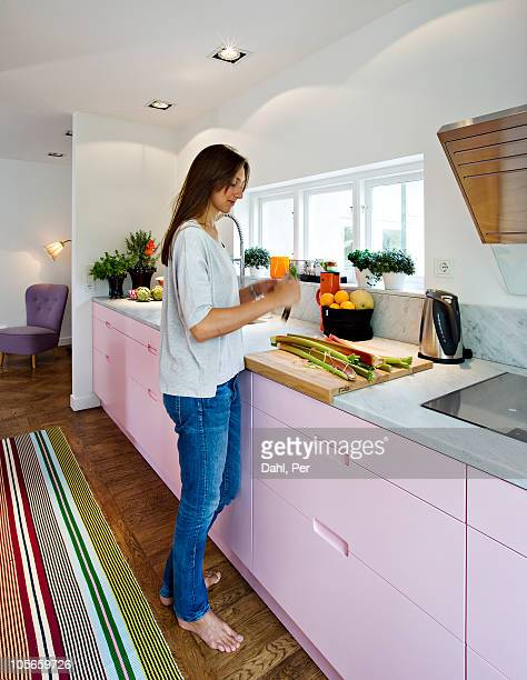 Scandinavia, Sweden, woman preparing food in kitchen