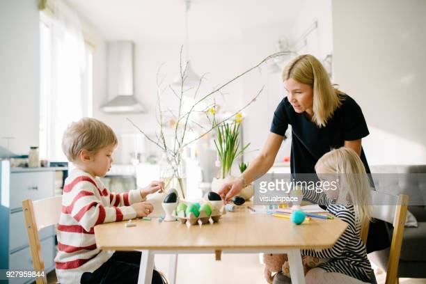 scandinavian family during easter holiday - happy easter mom stock pictures, royalty-free photos & images