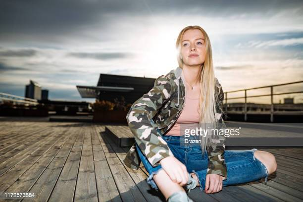 scandinavian generation-z blonde woman - military style stock pictures, royalty-free photos & images