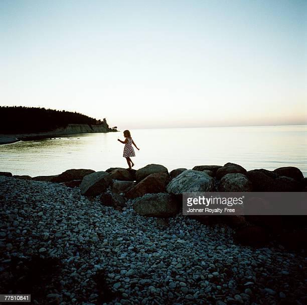 scandinavian girl playing on rocks gotland sweden. - gotland bildbanksfoton och bilder