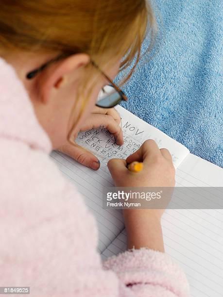Scandinavian girl writing in her diary.