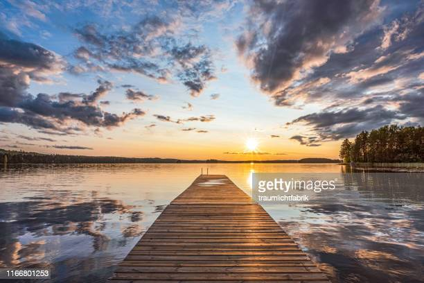 scandinavian lake at sunset - jetty stock pictures, royalty-free photos & images