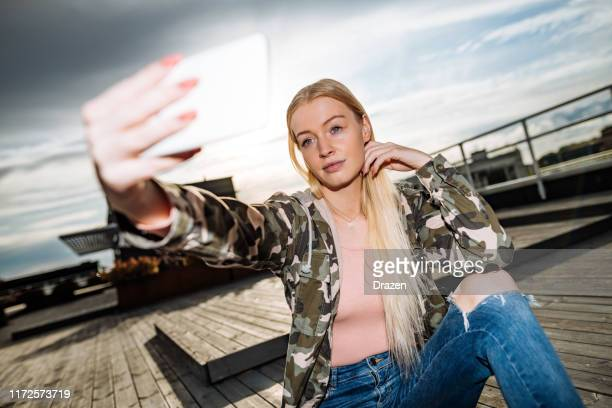 scandinavian looking generation-z blonde woman - military style stock pictures, royalty-free photos & images