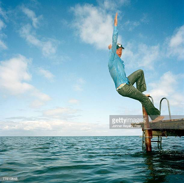 Scandinavian man falling into the water Oland Sweden.