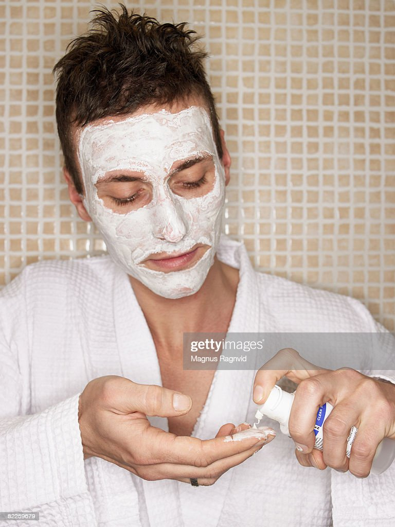 A Scandinavian man using face-cream. : Stock Photo