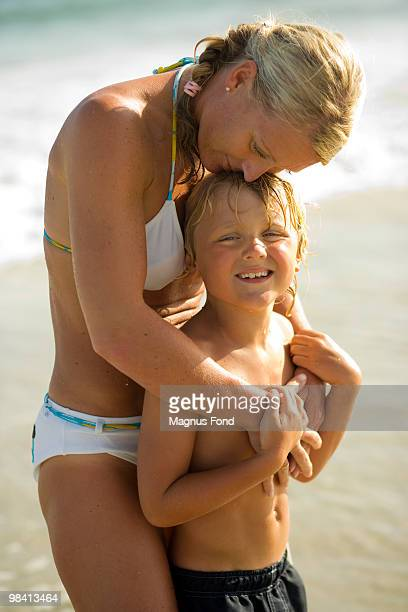 Scandinavian mother and son swimming.