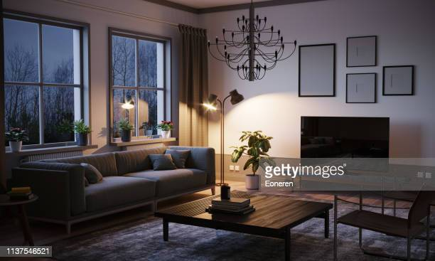 scandinavian style living room in the evening - cosy stock pictures, royalty-free photos & images
