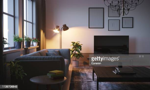 scandinavian style living room in the evening - electric lamp stock pictures, royalty-free photos & images